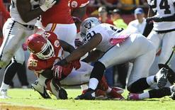 Oct 13, 2013; Kansas City, MO, USA; Kansas City Chiefs running back Jamaal Charles (25) scores a touchdown against Oakland Raiders defensive end Jack Crawford (91) in the second half at Arrowhead Stadium. Kansas City won the game 24-7. Mandatory Credit: John Rieger-USA TODAY Sports