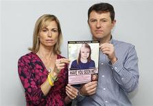 Kate and Gerry McCann are seen posing with a computer generated image of how their missing daughter Madeleine might look, during a news conference in London in this May 2, 2012 file photograph. REUTERS/Andrew Winning/Files