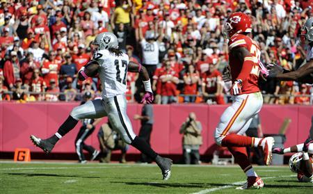 Oct 13, 2013; Kansas City, MO, USA; Oakland Raiders wide receiver Denarius Moore (17) scores a touchdown against the Kansas City Chiefs in the first half at Arrowhead Stadium. Mandatory Credit: John Rieger-USA TODAY Sports