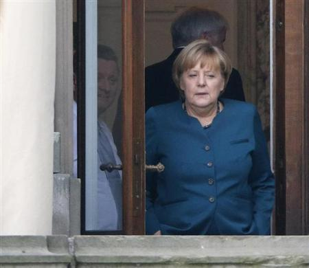 German Chancellor and leader of the Christian Democratic Union (CDU) Angela Merkel stands on a balcony while taking a break during preliminary coalition talks between Germany's conservative (CDU/CSU) parties and the Social Democrats (SPD) at the Parliamentary Society in Berlin October 4, 2013. REUTERS/Fabrizio Bensch