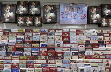 Christmas cards, wrapping and bags are seen for sale in Westgate shopping centre in east London August 17, 2013, 129 days before Christmas Day. REUTERS/Russell Boyce