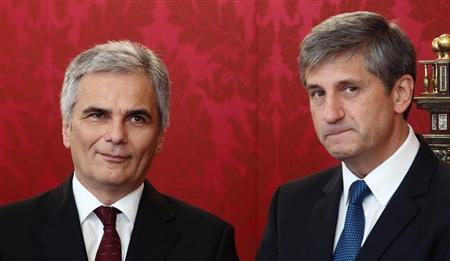 Austrian Chancellor Werner Faymann of the Social Democratic Party (SPOe) and Vice Chancellor Michael Spindelegger of the People's Party (OeVP) listen during the appointment of a caretaker government in the presidential office in Vienna October 1, 2013. REUTERS/Heinz-Peter Bader