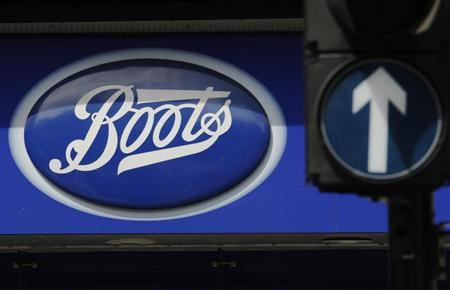A sign outside a store of pharmacy and cosmetics chain Boots is seen in London, May 16, 2011. REUTERS/Luke MacGregor