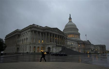 The U.S Capitol Building is pictured at sunset in Washington, October 11, 2013. REUTERS/Jason Reed