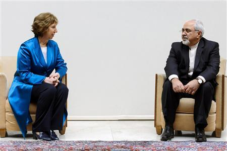 European Union foreign policy chief Catherine Ashton (L) speaks with Iranian Foreign Minister Mohammad Javad Zarif during a photo opportunity before the start of two days of closed-door nuclear talks at the United Nations offices in Geneva October 15, 2013. REUTERS/Fabrice Coffrini/Pool