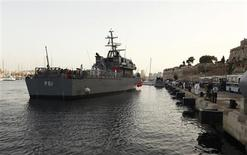 An Armed Forces of Malta (AFM) ship carrying rescued migrants arrives at the AFM Maritime Squadron base at Haywharf in Valletta's Marsamxett Harbour October 12, 2013. REUTERS/Darrin Zammit Lupi