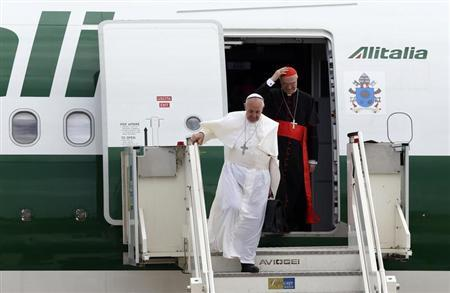 Pope Francis (L) and Cardinal Tarcisio Bertone step off a plane after returning from their trip to Brazil at Ciampino airport, south of Rome, July 29, 2013. REUTERS/Alessandro Bianchi