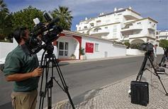 A camerman takes video footages outside the Ocean Club holiday resort, where Madeleine McCann disappeared in 2007, in Praia da Luz Southern Portugal October 14, 2013. REUTERS/Jose Manuel Ribeiro