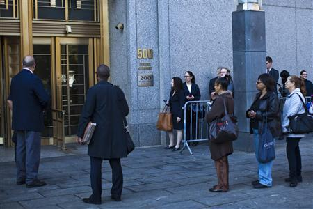 People wait in line to enter Manhattan's federal court where Nazih al-Ragye, known by the alias Abu Anas al-Liby, is expected for arraignment in New York, October 15, 2013. REUTERS/Eduardo Munoz