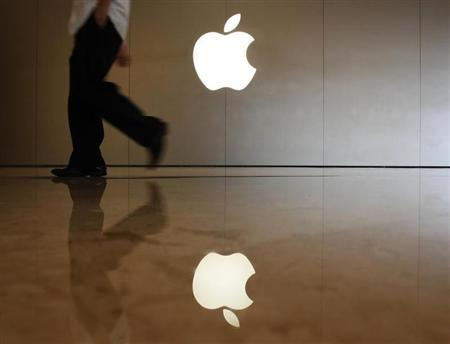 A man walks past the logo at an Apple store in the southern Chinese city of Shenzhen, neighbouring Hong Kong September 9, 2013. REUTERS/Bobby Yip