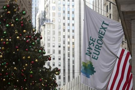The NYSE Euronext flag hangs outside the New York Stock Exchange in New York December 20, 2012. REUTERS/Andrew Kelly