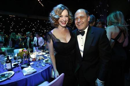 ''Mad Men'' creator Matthew Weiner (R) with ''Mad Men'' actress Christina Hendricks pose at the Governors Ball for the 65th Primetime Emmy Awards in Los Angeles September 22, 2013. REUTERS/Mario Anzuoni