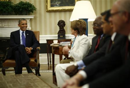 U.S. President Barack Obama meets with U.S. House of Representative leadership in the Oval Office of the White House in Washington, October 15, 2013. REUTERS/Jason Reed