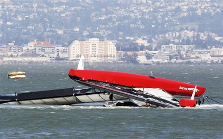 The Artemis Racing yacht is towed to shore after capsizing in the San Francisco Bay, California May 9, 2013. REUTERS/Jed Jacobsohn