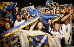 Bosnia soccer national team fans celebrate their 2014 World Cup qualifying match victory over Lithuania, in Sarajevo October 15, 2013. REUTERS/Dado Ruvic