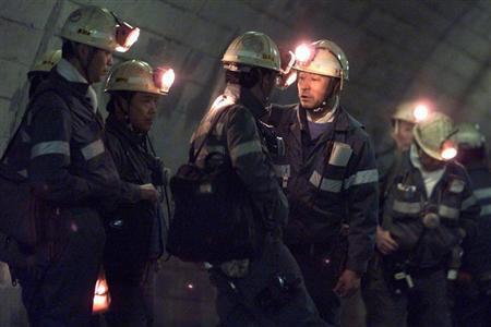 Japanese coal miners wait to enter the undersea mine at the Taiheiyo Coal Mining Company in Kushiro on northern island of Hokkaido, December 28, 2001. REUTERS/Kimimasa Mayama