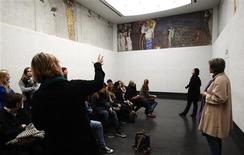 Visitors look at Gustav Klimt's Beethoven Frieze, one of the country's most famous artworks, at the Secession museum in Vienna October 16, 2013. REUTERS/Heinz-Peter Bader