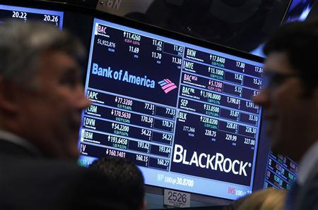 A screen displays the trading price for Bank of America and Black Rock stocks on the floor of the New York Stock Exchange, in this January 17, 2013 file photo. REUTERS/Brendan McDermid/Files