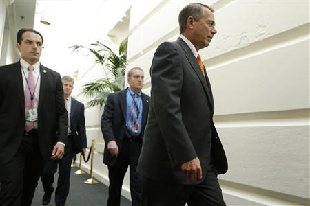 U.S. House Speaker John Boehner (R-OH) (R) arrives with his security detail for a House Republican caucus meeting at the U.S. Capitol in Washington, October 16, 2013. REUTERS/Jonathan Ernst