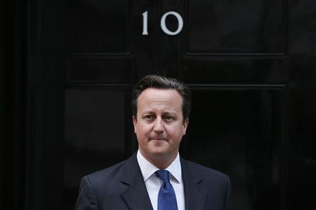 Britain's Prime Minister David Cameron waits to greet the President of the European Council, Herman Van Rompuy, outside 10 Downing Street in central London October 8, 2013. REUTERS/Stefan Wermuth