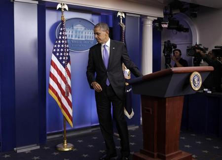 U.S. President Barack Obama leaves the briefing room of the White House in Washington after the Senate passed the bill to reopen the government, October 16, 2013. REUTERS/Yuri Gripas