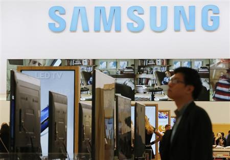A journalist walks at the Samsung booth during a media preview day at the IFA consumer electronics fair in Berlin, September 5, 2013. REUTERS/Fabrizio Bensch