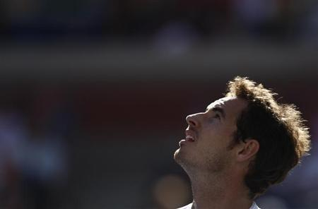 Andy Murray of Britain reacts after a missed point against Stanislas Wawrinka of Switzerland at the U.S. Open tennis championships in New York September 5, 2013. REUTERS/Eduardo Munoz