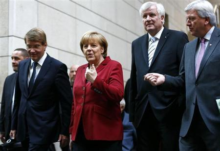 German Chancellor and leader of the Christian Democratic Union (CDU) Angela Merkel and party members arrive for preliminary coalition talks with the Social Democratic Party (SPD) at the Parliamentary Society in Berlin October 17, 2013. REUTERS/Tobias Schwarz