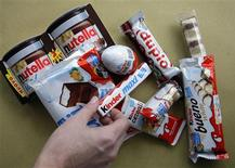 A woman takes a Kinder Ferrero chocolate in Milan November 20, 2009. REUTERS/Stefano Rellandini