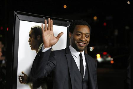 Cast member Chiwetel Ejiofor waves at a special screening of ''12 Years a Slave'' at the Directors Guild of America in Los Angeles, California in this file photo taken October 14, 2013. REUTERS/Mario Anzuoni/Files