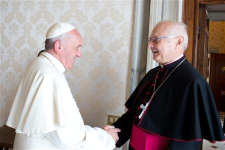 Pope Francis meets Archbishop Robert Zollitsch (R), head of the German bishops' conference, during a private audience at the Vatican October 17, 2013. REUTERS/Osservatore Romano