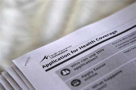 The federal government forms for applying for health coverage are seen at a rally in Jackson, Mississippi October 4, 2013. REUTERS/Jonathan Bachman