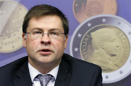 Latvia's Prime Minister Valdis Dombrovskis addresses a news conference on the adoption of the euro by Latvia at the European Union council building in Brussels July 9, 2013. REUTERS/Francois Lenoir