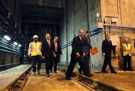 New York City Mayor Michael Bloomberg and other city officials walks in a tunnel some 200 feet below New York City's Central Park to announce the completion and activation of the Manhattan portion of the city's third water tunnel (Tunnel No.3) October 16, 2013. REUTERS/Mike Segar