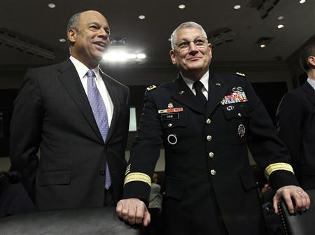 Pentagon general counsel Jeh Johnson (L) and Army General Carter Ham talk before a Senate Arms Services Committee hearing on Capitol Hill in Washington in this file photo taken December 2, 2010. REUTERS/Kevin Lamarque/Files