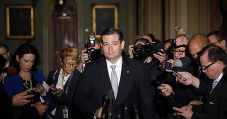 Reporters gather around U.S. Senator Ted Cruz (R-TX), who announces he will not filibuster, as he talks to reporters after a Republican Senate caucus meeting at the U.S. Capitol in Washington October 16, 2013. REUTERS/Jonathan Ernst