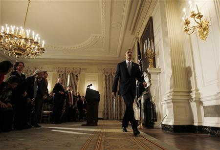 U.S. President Barack Obama departs the White House State Dining Room after delivering remarks on the end of the U.S. government shutdown in Washington, October 17, 2013. REUTERS/Jason Reed
