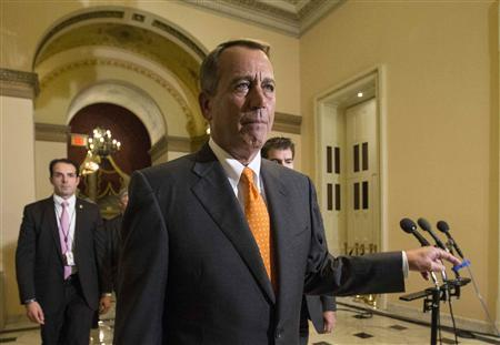 Speaker of the House John Boehner walks to the House floor during the vote on the fiscal deal in the U.S. Capitol in Washington October 16, 2013. REUTERS/Kevin Lamarque