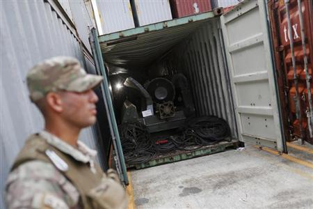 A police officer stands guard at a container holding arms seized from the North Korean flagged ship ''Chong Chon Gang'' at the Manzanillo Container Terminal in Colon City July 17, 2013. REUTERS/Carlos Jasso