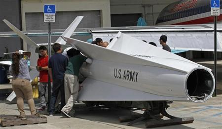 Miami area high school students at the George T. Baker Aviation school prepare to attach ailerons to a 41-foot surface-to-air Nike Hercules missile as they restore it at the school in Miami, Florida October 10, 2012. REUTERS/Joe Skipper