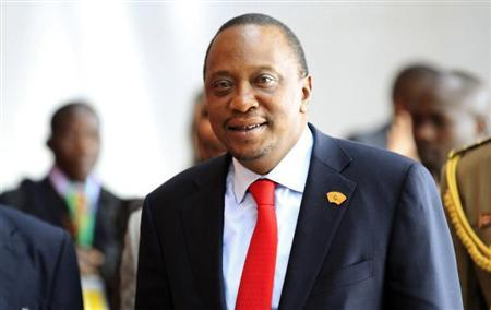 Kenya's President Uhuru Kenyatta arrives for the extraordinary session of the African Union's Assembly of Heads of State and Government on the case of African Relationship with the International Criminal Court (ICC), in Ethiopia's capital Addis Ababa, October 12, 2013. REUTERS/Tiksa Negeri