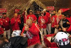 Oct 18, 2013; St. Louis, MO, USA; St. Louis Cardinals right fielder Carlos Beltran (middle) celebrates in the clubhouse with his teammates after game six of the National League Championship Series baseball game against the Los Angeles Dodgers at Busch Stadium. Mandatory Credit: Jeff Curry-USA TODAY Sports