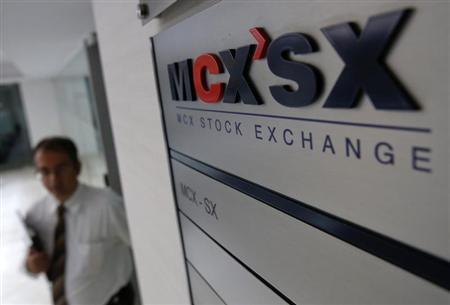 A staff member walks past the MCX-SX logo at their Exchange Square building in Mumbai February 11, 2013. REUTERS/Vivek Prakash