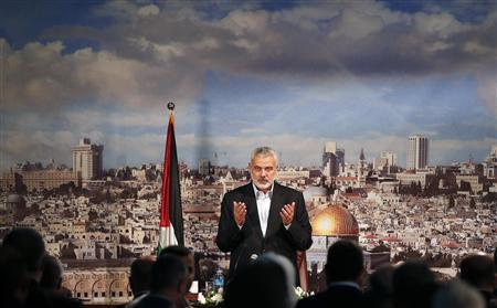Ismail Haniyeh, prime minister of the Hamas Gaza government, prays before delivering a speech in Gaza City October 19, 2013. REUTERS/Mohammed Salem