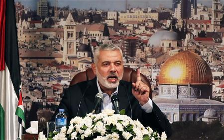 Ismail Haniyeh, prime minister of the Hamas Gaza government, gestures as he delivers a speech in Gaza City October 19, 2013. REUTERS/Mohammed Salem