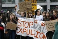 "French high students shout slogans as they stand behind a banner which reads in part, ""Stop Expulsions"", during a demonstration in Paris October 18, 2013. Students blocked schools and demonstrate for a second day to protest over the expulsion of a 15-year-old Kosovar schoolgirl, Leonarda Dibrani, who was arrested by police during a school trip and deported to Kosovo, and also in support of another deported student of Armenian descent, Khatchik Kachatryan. REUTERS/Gonzalo Fuentes"