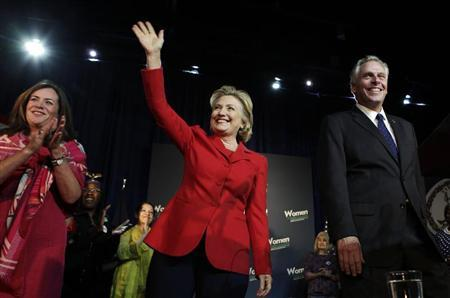 Former U.S. Secretary of State Hillary Clinton waves to the audience at an event to endorse Virginia gubernatorial candidate and former DNC chairman Terry McAuliffe (R) at The State Theatre in Falls Church, Virginia, October 19, 2013. REUTERS/Yuri Gripas