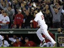 Oct 19, 2013; Boston, MA, USA; Boston Red Sox right fielder Shane Victorino (18) reacts after hitting a grand slam during the sixth inning in game six of the American League Championship Series baseball game against the Detroit Tigers at Fenway Park. Mandatory Credit: Bob DeChiara-USA TODAY Sports