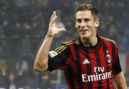 AC Milan's Valter Birsa celebrates after scoring against Udinese during their Italian serie A soccer match at the San Siro stadium in Milan October 19, 2013. REUTERS/Alessandro Garofalo