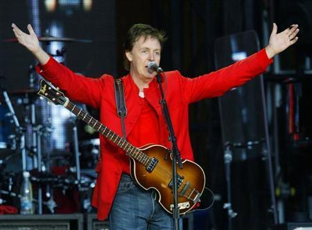 British singer and songwriter Sir Paul McCartney greets spectators at the begining of his concert in the Czech Republic capital of Prague, June 6, 2004. REUTERS/Petr Josek